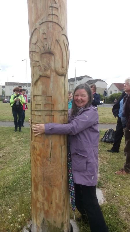 Jean hugging totem pole