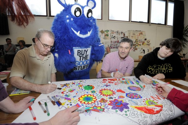 Whale Arts service users (from left) Gary Stewart, Kenneth Richie and Michelle Roxburgh are pictured in one of the doodling classes with Live the Good Stuff's mascot Dougie Goodstuff lending a hand
