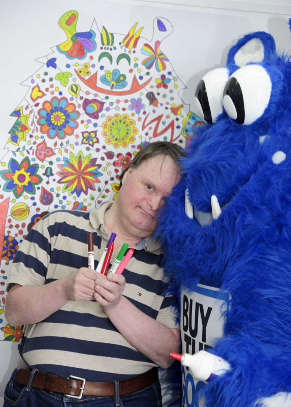 Whale Arts service user Damian McLean is pictured with Live the Good Stuff's mascot Dougie Goodstuff