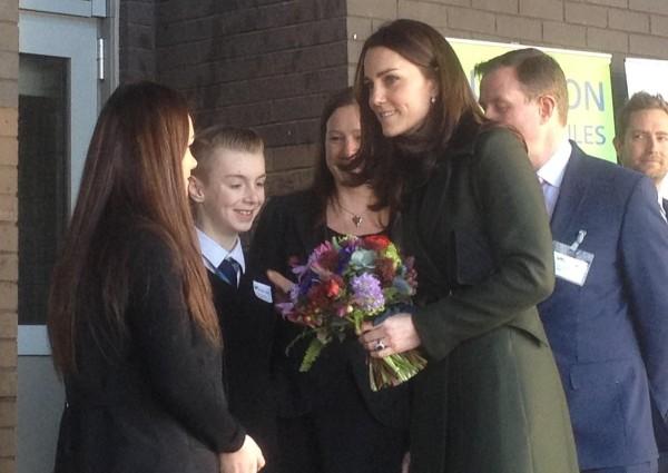 Pupils Kelsey Evans and Scott Cunningham hand Duchess of Cambridge bouquet