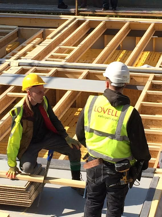 Ewen Bremner (yellow hard hat) on site with Lovell in Wester Hailes, Edinburgh