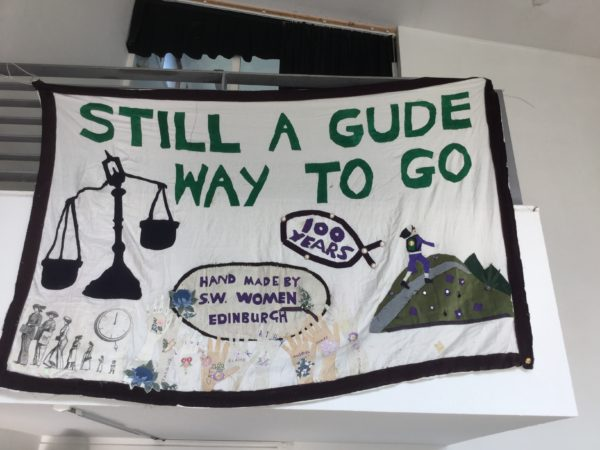 A banner made by local textile group Stitch 'n' Time commemorating the work of the Suffrage movement.